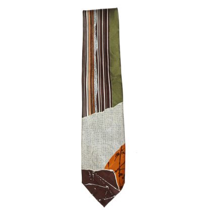 Como House textured silk tie with a design in green, browns and cream