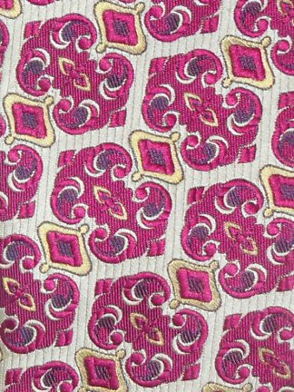 Bright pink with a touch of yellow design retro tie on a cream textured background