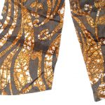 Bown silk cravat with a floral and paisley batik design