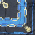 Cartier Silk scarf in a blue, black and gold design with the logo in the centre