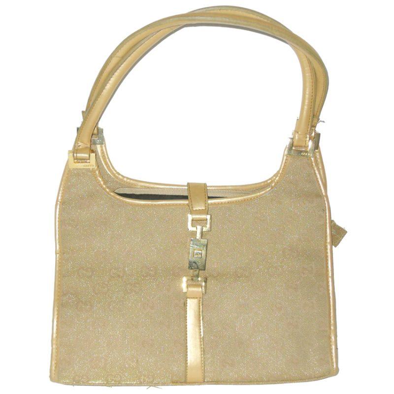 Vintage Gucci gold coloured fabric handbag