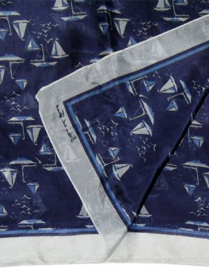 Sheer silk scarf with a design of sail boats on a dark blue background