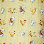 Hermes silk tie with a chicken rabbit and egg design on a yellow background