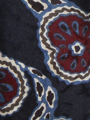 Vibrant designer silk tie on a textured silk background