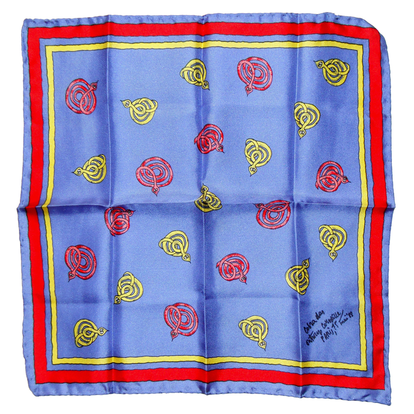 Handrolled edge silk pocket square with yellow and red cobras on a blue background