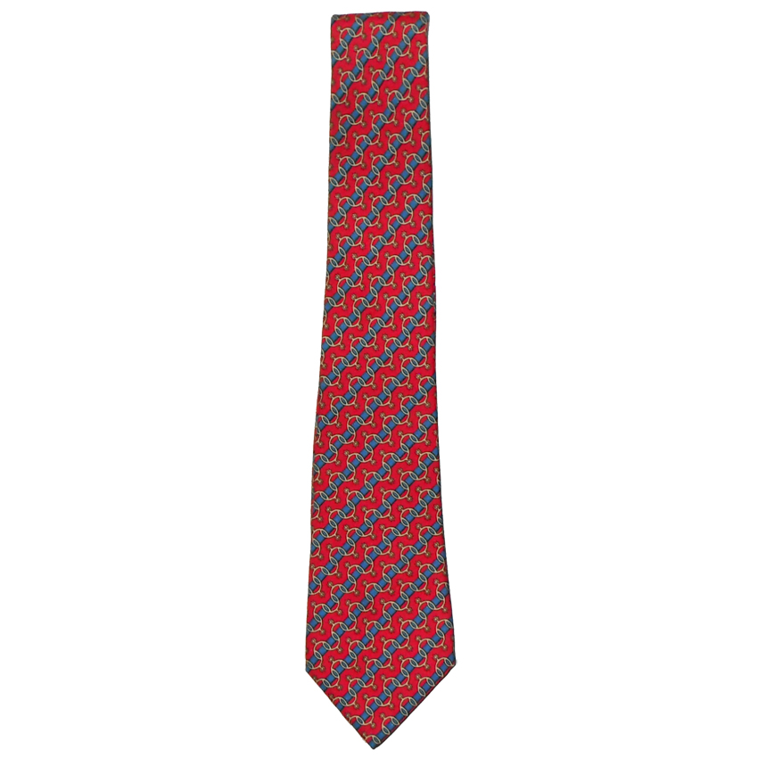 Hermes spur design on red background silk tie