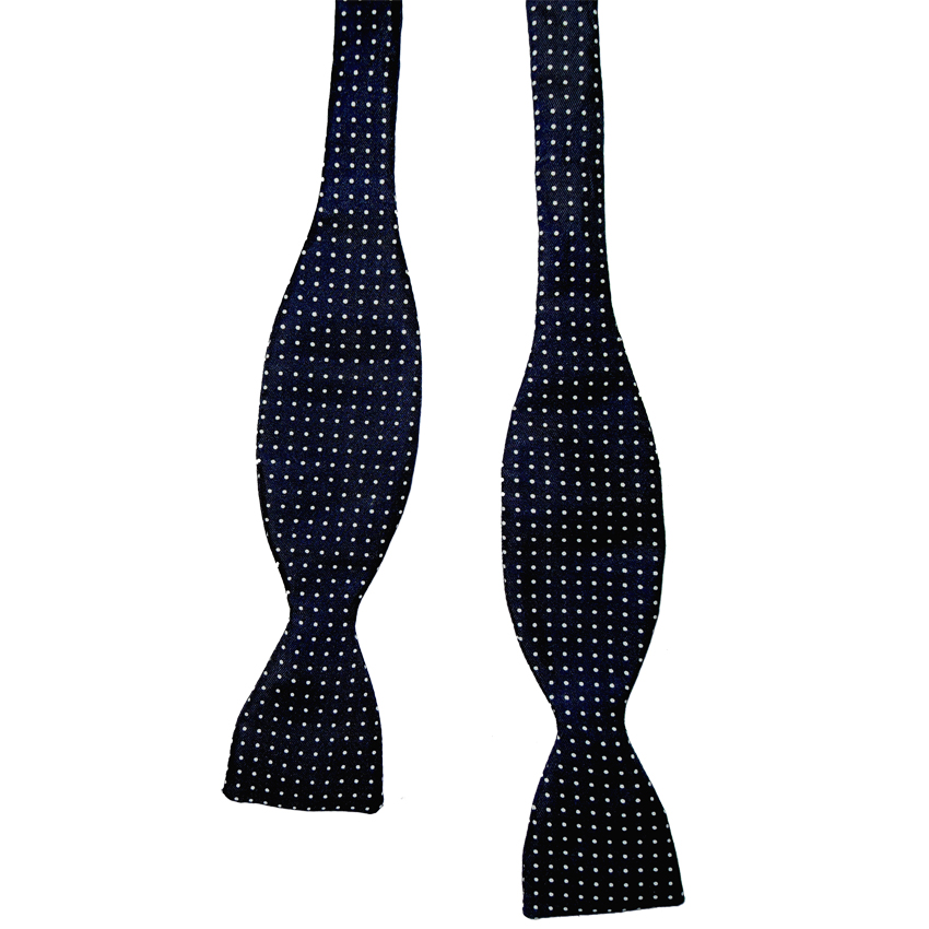 Silk self tie bow tie with a navy blue background and a small white dot design