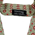 Vintate Tootal rayon cravat with a yellow background and small square design with red