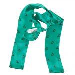 Narrow width green silk cravat with a brass horn design