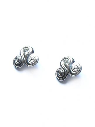 Silver tone clip on earrings set with a large crystal