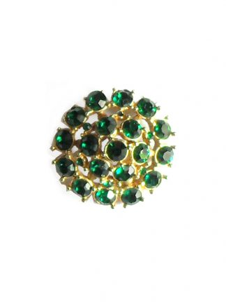 Gold tone brooch set with green stones