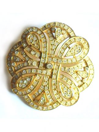 Gold tone metal and clear stone brooch