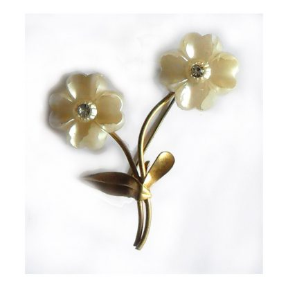 White flower brooch with clear stones