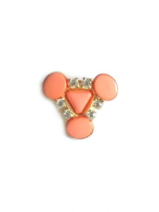 Orange plastic and clear stone brooch